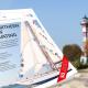 Das Life Science Nord Magazin vor einer Küste mit Leuchtturm